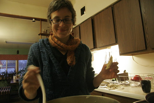 heather stirs soup