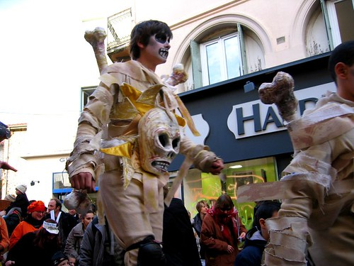 Young skeletons on stilts in the parade.