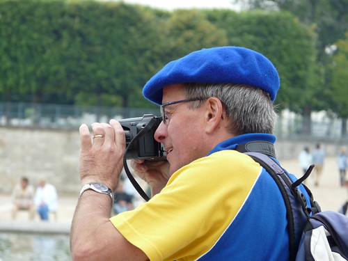 Rugby supporter with his beret, taking a photo