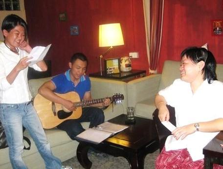 Handsome young guitarist serenades Birthday Girl