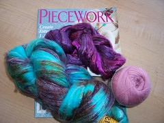 Thats May/June 2008 lace issue of Piecework, 2 ounces of bombyx silk in shades of purple, some Yarn Place Gentle cashmere/merino laceweight in a lovely rose color, and 4 ounces of bamboo/nylon/merino in turquoise, brown, green, and purple.