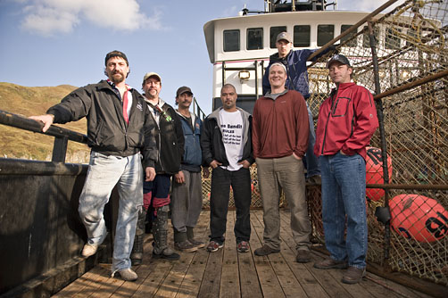 The crew of the Time Bandit on the deck of the Time Bandit in Dutch Harbor Alaska