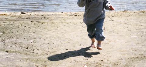 Elizabeth, running on the beach