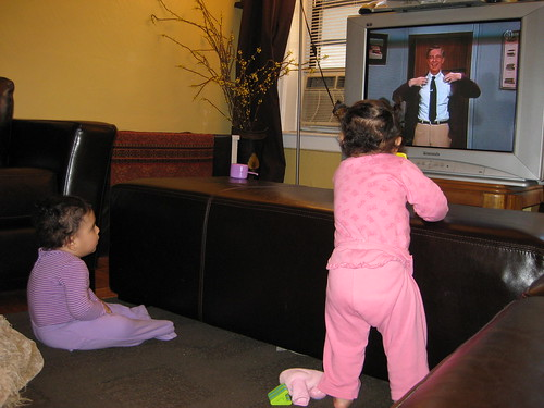 The girls watching Mr. Rogers by you.