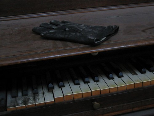 Abandoned glove in the Cathedrale that may or may not have been used to press down those five broken piano keys.