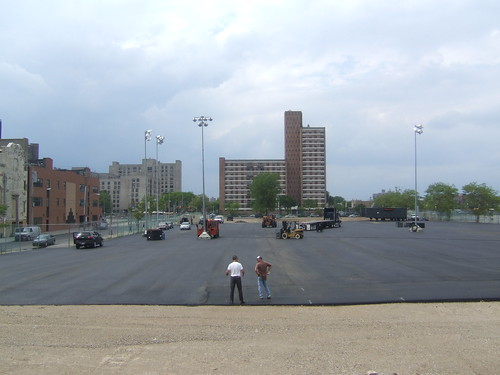 As May turned to June, dirt turned to blacktop -- and lighting for the Ringling Circus site in Coney Island was being installed. Photo by rbbbconeyisland via flickr