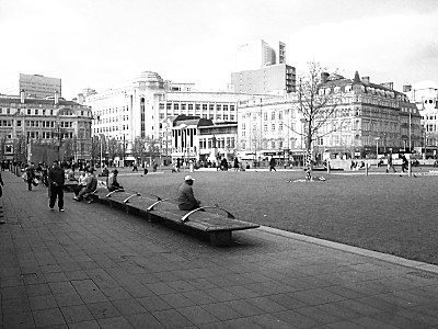 looking across Piccadilly Gardens towards the Arndale Centre and Debenhams.