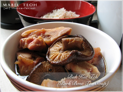 Bak Kut Teh (Pork Bone Tea) with a bowl of rice mixed with fried shallots!