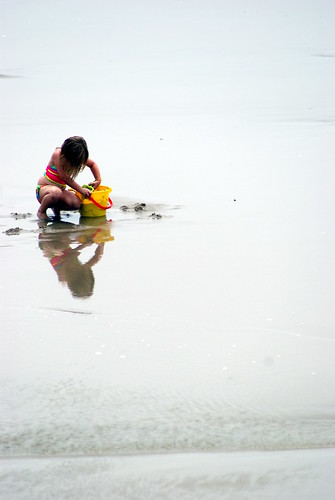 Child at the beach with a bucket