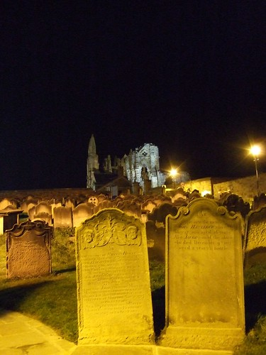 Whitby, cliff-side graves with Abbey in the distance.