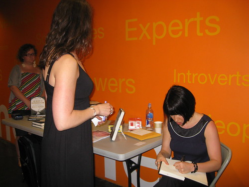 Michelle Goldberg signing books at Babeland