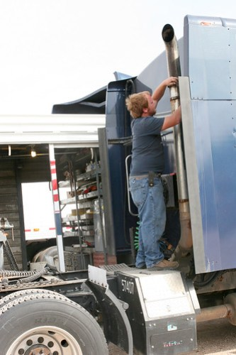 Johan fixes a smoke stack.