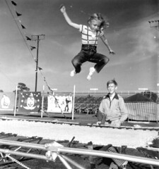 Young girl jumping on a trampoline at the Sarasota High School Sailor Circus