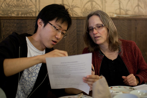 Vincent and Professor Rhonda Righter discussing the little puzzle sheet thing we got