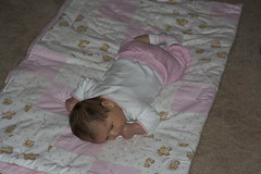 Elena practices motor skills during tummy time as well as camouflage skills.