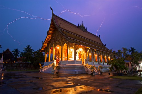 This is a 30 second exposure at f/13 and ISO 200.  I set the shutter at 30 sec, then adjusted the aperture until the temple was properly exposed.  Louang Prabang, Laos.