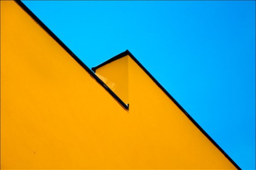 a yellow wall black border blue sky by Niklas Plessing