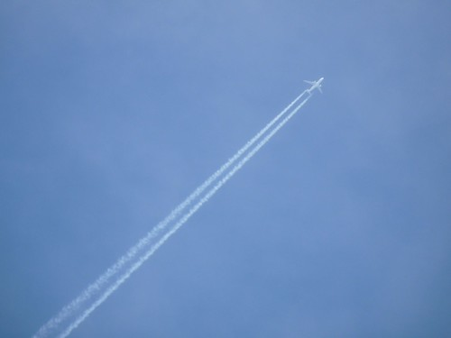 Jet with contrails