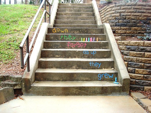 "steps written on in bright coloured chalk: ""down they forgot as up they grew"""