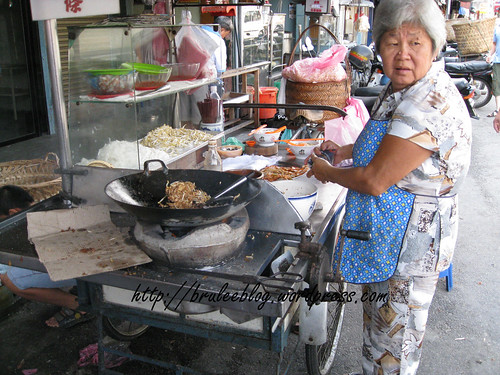 Hawker frying noodles