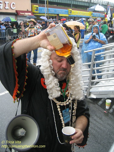 The first bribe of the Mermaid Parade? The Chief Justice pouring rum. Photo © Tricia Vita/me-myself-i via flickr