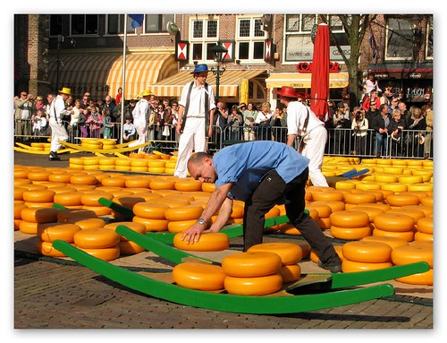 A zetter loading cheese onto the barrow by you.