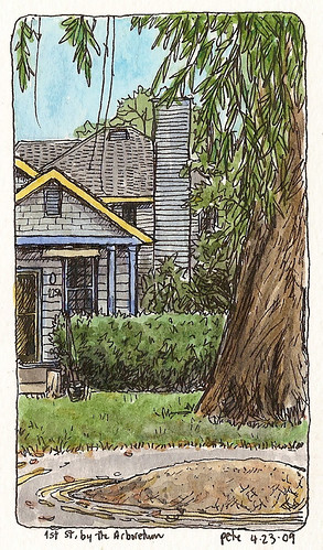 a blue house by arboretum