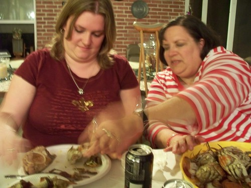 Mom shows Erin how to open crabs... apparently at super-speed.