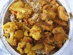 Chicken tikka masala w/ cauliflower & potatoes over rice