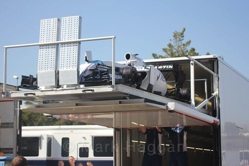 A Williams car being offloaded from a truck at Formula One Winter Testing