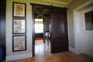 Double set of Rolling Barn Doors on either side of Laundry  room.