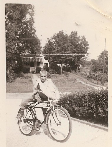 BOY ON SCHWINN BIKE DELIVERING PAPERS 1955