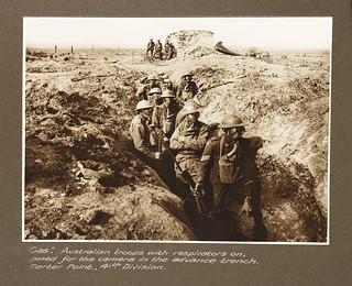 """""""Gas."""" Australian troops with respirators on posed for the camera in the advance trench, Garter Point, 4th Division"""