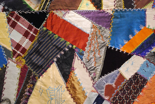 colorful patchwork sewn in a crazy quilt pattern