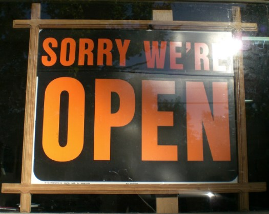 'sorry we're open' sign
