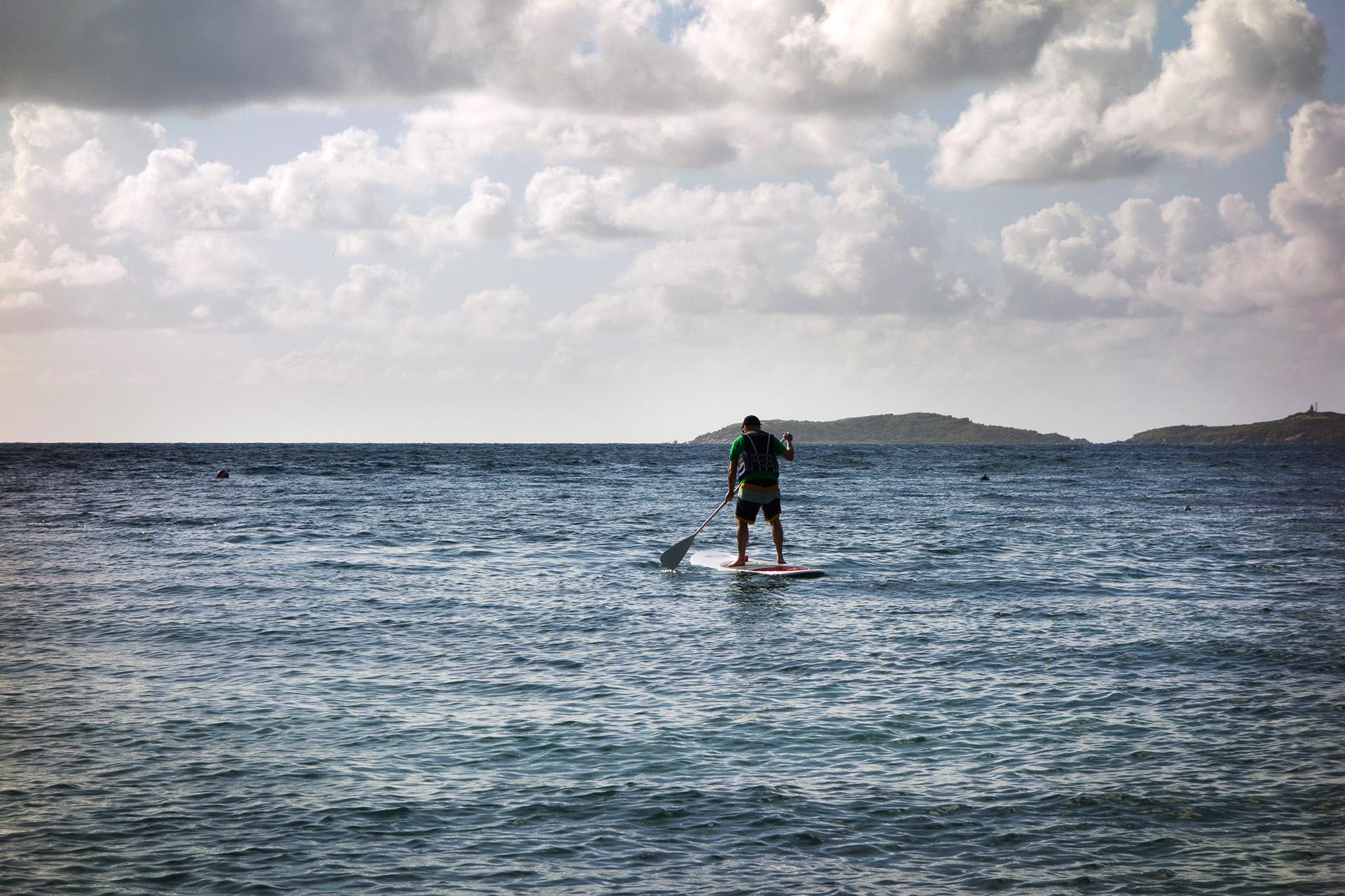 Matt paddle boarding in Bolongo Bay.