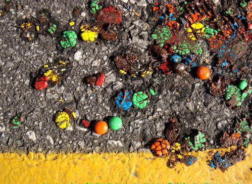 m&ms on asphalt