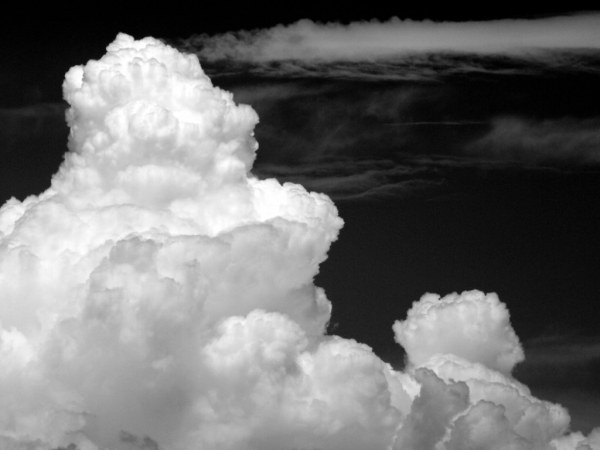 Towers in the Sky by Bryce Bradford. Red filters can be used to create strong contrast in a partly cloudy sky.