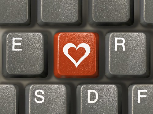 Keyboard (closeup), red key with heart