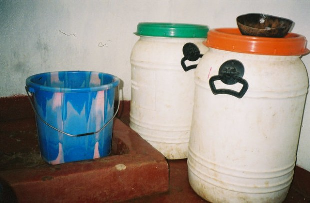 My shower: A bucket, a shell, and two canisters of water from the UN