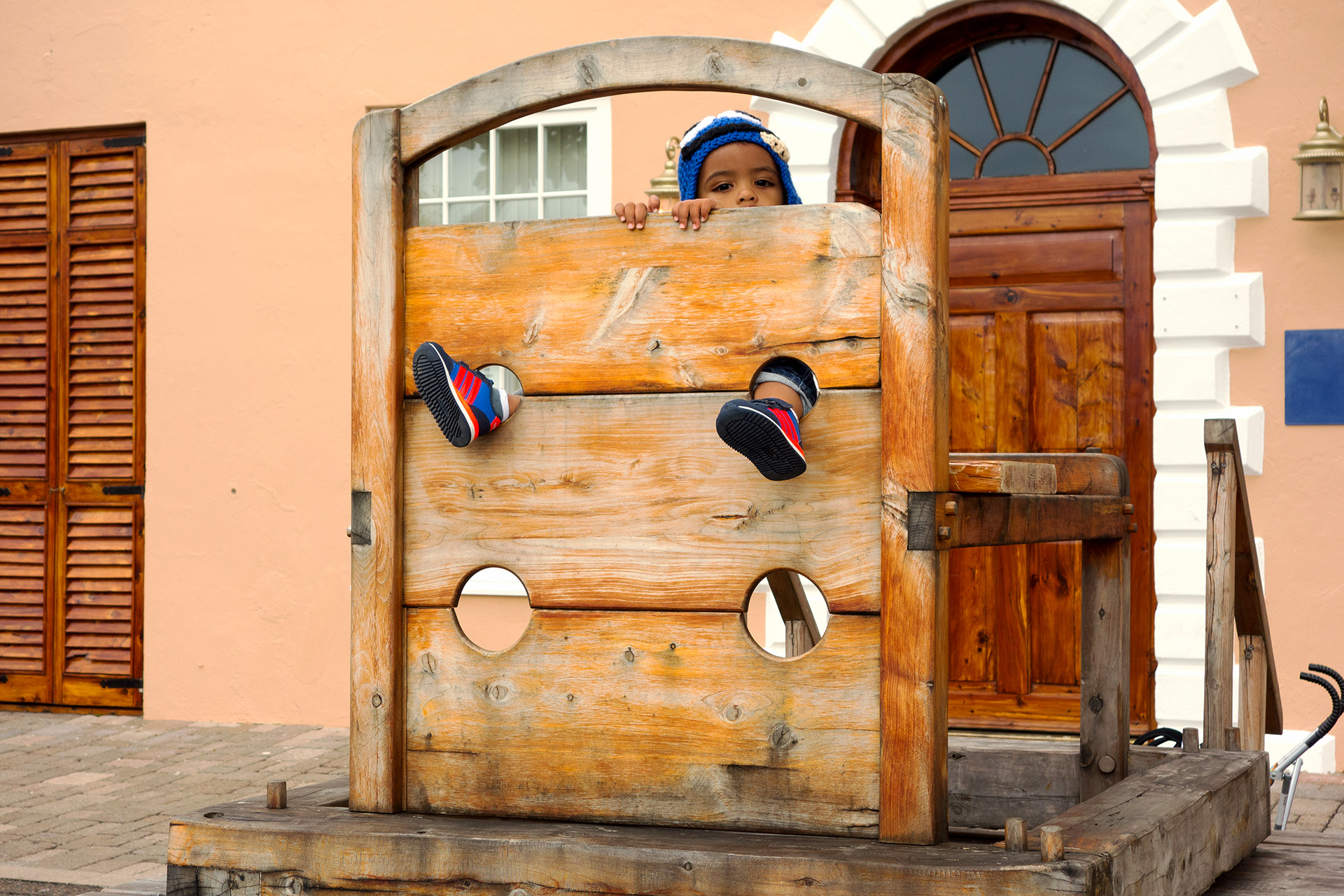 Super cute kid doing time in the stocks.