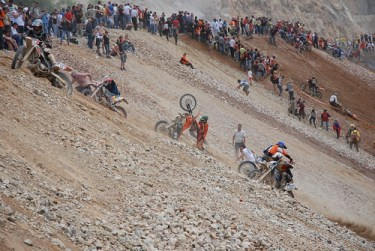 dragging their bikes uphill