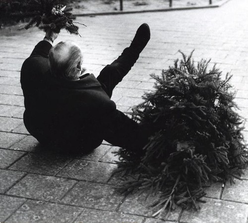 Man falling over with Christmas tree