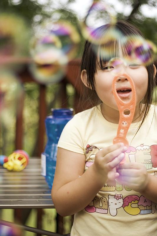 Emi blowing bubbles