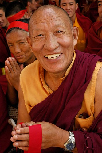 Very happy Tibetan Buddhist Monk holding ritual blindfold during Lamdre, Tharlam Monastery, Boudha, Kathmandu, Nepal