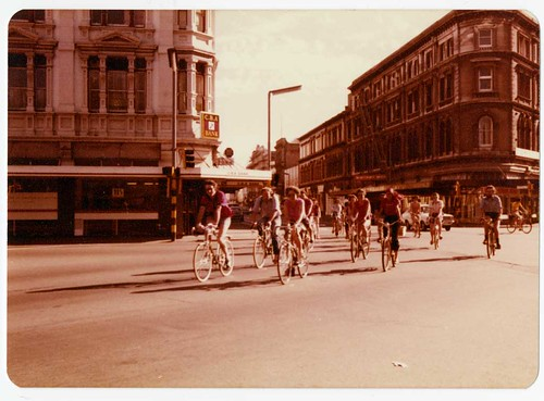 Library staff cycling through Christchurch town centre, At the intersection of High, Manchester and Lichfield Streets. 1980s