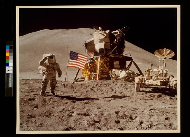 Astronaut James Irwin gives salute beside U.S. flag during lunar surface extravehicular activity (EVA)