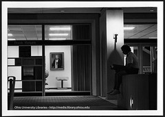 Student outside Ohio University's Alden Library's 4th floor entrance at night, ca 1980s
