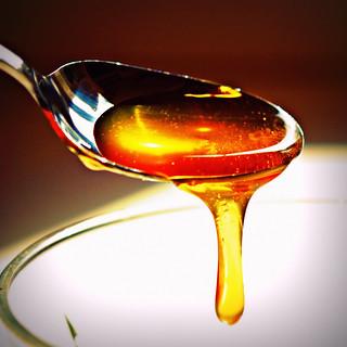 Sweet honey on the spoon