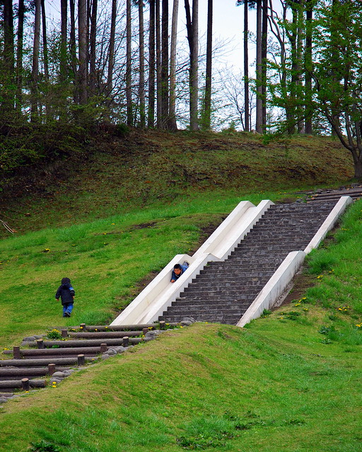 Child sliding down the stair slide